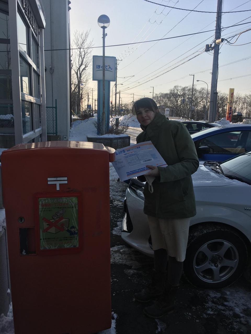 penpal project photo of me sending letters at mailbox